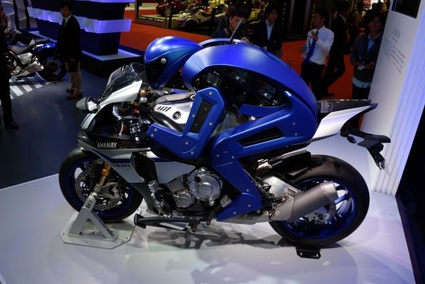 The Yamaha Motor Co. Motobot sits on the Yamaha R1M motorcycle at the Tokyo Motor Show in Tokyo, Japan, on Thursday, Oct. 29, 2015.