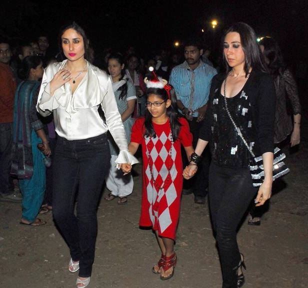 Kareena Kapoor and Karisma Kapoor with her daughter came out to St. Andrews Church in Bandra for Christmas celebrations on December 24, 2012 in Mumbai, India.
