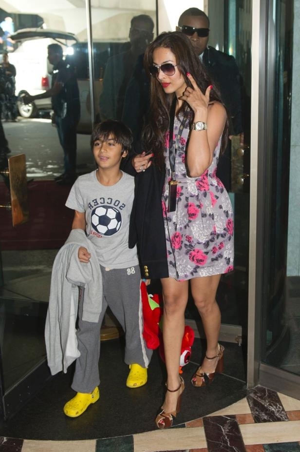 Malaika Arora Khan arrives with her son Arhaan in Toronto, June 23, 2011. The International Indian Film Academy (IIFA) Awards will be held in Toronto June 25th.