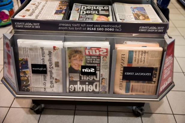 Copies of The Sun tabloid are displayed alongside other newspapers for sale in a shop in London, Tuesday, Jan. 20, 2015. Has the sun set on the topless models of Britain's tabloid press? For 45 years, the Rupert Murdoch-owned tabloid The Sun has featured topless models called Page 3 girls — photos that have long drawn protests from feminists. On Monday, it showed model Rosie Huntington-Whitely wearing a bra and the Murdoch owned Times newspaper reported Tuesday that it understands topless models will no longer appear on page 3.