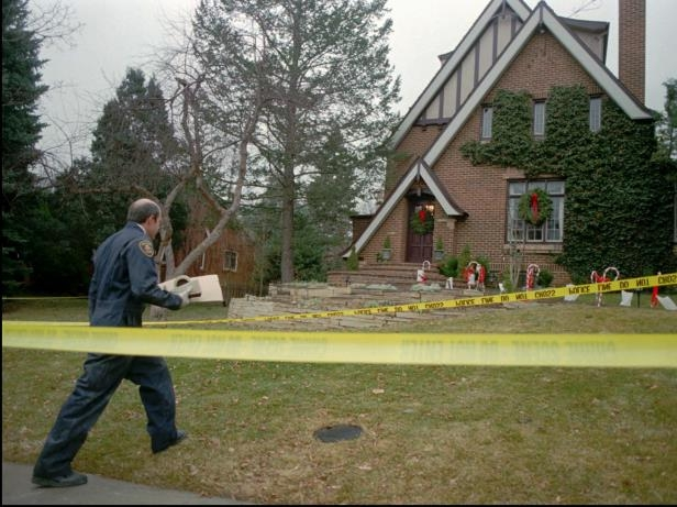 A Boulder Police detective walks to the home of John and Patricia Ramsey in Boulder, Colo., on Friday, Jan. 3, 1997, as investigators sifted through evidence in the home in which the couple's 6-year-old daughter was found murdered on Dec. 26, 1996. A decade after the Christmastime slaying of JonBenet Ramsey, two aspects of the case endure: the public's endless fascination with the murder of the 6-year-old beauty contestant, and a sense the notorious crime may never be solved.