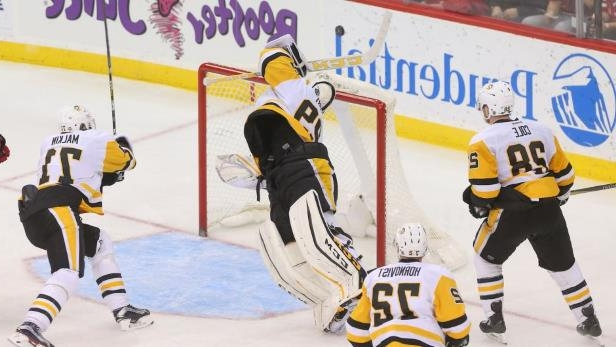 on sale e5394 f2ac9 Sport: Watch Marc-Andre Fleury dive and bat puck out of mid ...