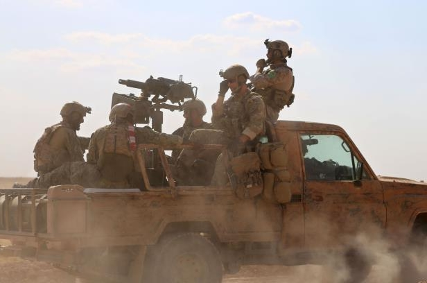 World: U S  troops carry out ground raid against ISIS in