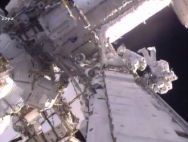 This still image taken from video provided by NASA shows U.S. astronaut Shane Kimbrough, left and French astronaut Thomas Pesquet during a space walk outside the International Space Station, Friday, Jan. 13, 2017. The astronauts are taking another spacewalk to plug in new and better batteries outside the space station. It's the same type of job conducted last Friday. Pesquet is the first French spacewalker in 15 years. (NASA via AP)