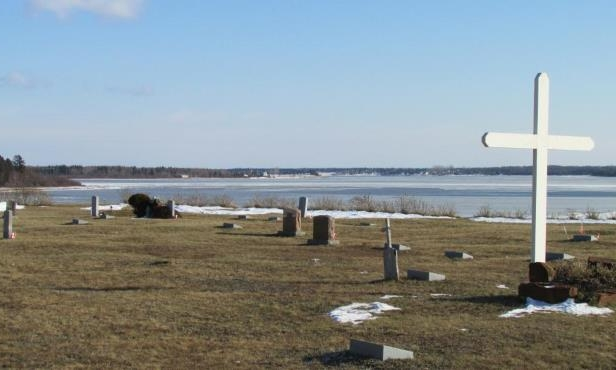 The community spent tens of thousands of dollars to build a rock wall to shore up Lennox Island's cemetery against the rising waters.
