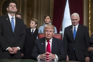 Trump, in Oval Office, signs first executive order on Obamacare