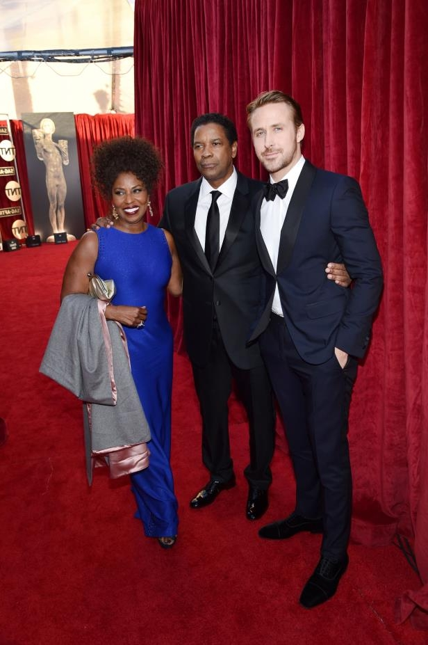 Slide 16 of 98: LOS ANGELES, CA - JANUARY 29:  Actors Ryan Gosling, Denzel Washington and Pauletta Washington attend The 23rd Annual Screen Actors Guild Awards at The Shrine Auditorium on January 29, 2017 in Los Angeles, California.  (Photo by John Shearer/Getty Images