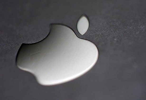 The Apple logo is pictured on an iPhone in an illustration photo.