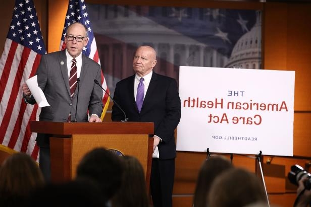 Reps. Kevin Brady, R-Texas, left, and Greg Walden, R-Ore., discuss Republicans' new health care legislation on March 7, 2017.