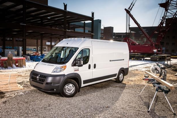 Slide 1 of 3: 032-2016-Ram-ProMaster-3500-EcoDiesel-cargo-van-front-passenger-side-view-at-construction-site.jpg