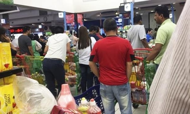 People are seen buying food staples at a supermarket in Doha, Qatar, Monday, June 5, 2017.