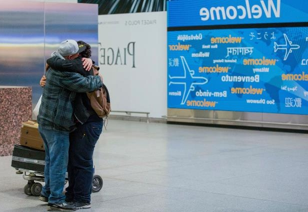 Abdullah Alghazali, right, hugs his 13-year-old son Ali Abdullah Alghazali after the Yemeni boy stepped out of an arrival entrance at John F. Kennedy International Airport in New York on Feb. 5, 2017. U.S. Customs and Border Protection officers will be key players in putting President Trump's revised travel ban into effect on June 29, affecting visitors from six mostly Muslim countries: Iran, Libya, Somalia, Sudan, Syria, and Yemen.