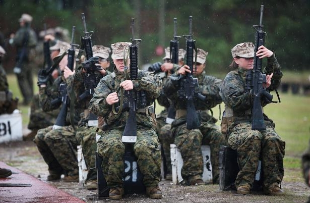 Image: Female Marine recruits prepare to fire on the rifle range