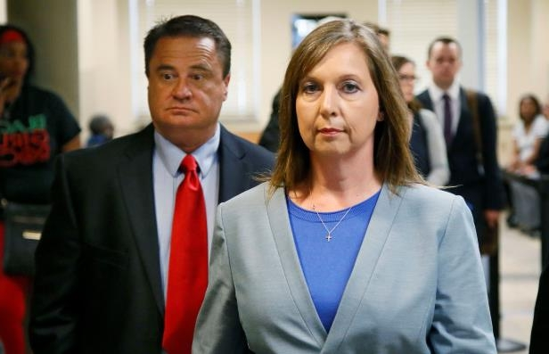Betty Shelby leaves the courtroom with her husband, Dave Shelby, right, after the jury in her case began deliberations in Tulsa, Okla. Shelby, who fatally shot an unarmed black man last year, was found not guilty of first-degree manslaughter. Shelby's attorney said Tuesday, May 23, 2017, that Shelby is back on the force working in an