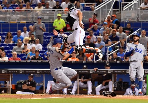Slide 1 of 74: Marlins' J.T. Realmuto tries to tag out Dodgers' Joc Pederson at home plate om July 14 in Miami, FL.