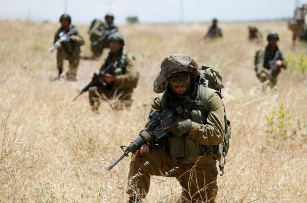 Israeli soldiers from the 605 Combat Engineering Corps battalion take part in a training session on the Israeli side of the border between Syria and the Israeli-occupied Golan Heights June 1, 2016.