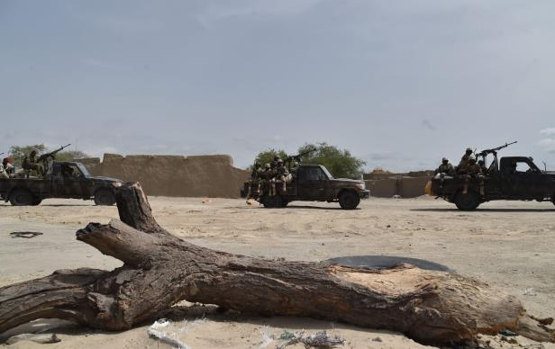 Niger's army convoy arrives in the city of Bosso on June 17, 2016 following attacks by Boko Haram fighters in the region.
