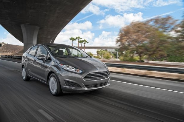 Slide 2 of 12: 2014-Ford-Fiesta-SFE-EcoBoost-front-three-quarters-in-motion1.jpg