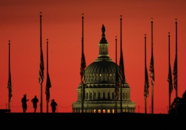 The U.S. Capitol dome backdrops flags at half-staff in honor of the victims killed in the Las Vegas shooting as the sun rises on Tuesday, Oct. 3, 2017, at the foot of the Washington Monument on the National Mall in Washington.: Disarm the opposition with policy talk.