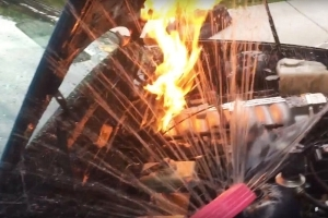 Watch This Guy Battle An Engine Fire With A Yard Sprinkler