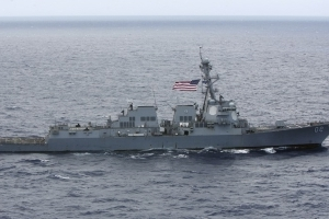 U.S. warship sails near islands Beijing claims in South China Sea - U.S. officials