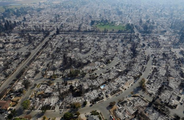 Homes burned by a wildfire are seen Wednesday, Oct. 11, 2017, in Santa Rosa, Calif. Wildfires whipped by powerful winds swept through Northern California sending residents on a headlong flight to safety through smoke and flames as homes burned. (AP Photo/Jeff Chiu)
