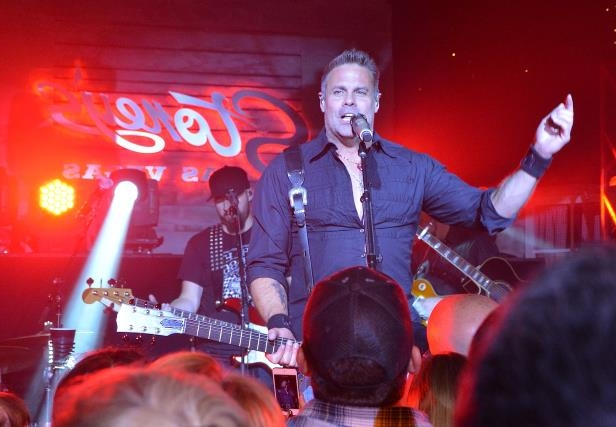 Slide 20 of 148: Recording artist Troy Gentry of music duo Montgomery Gentry performs at Stoney's Rockin Country on November 4, 2016 in Las Vegas, Nevada. (