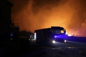 Portugal wildfires kill 27; 3 dead across border in Spain