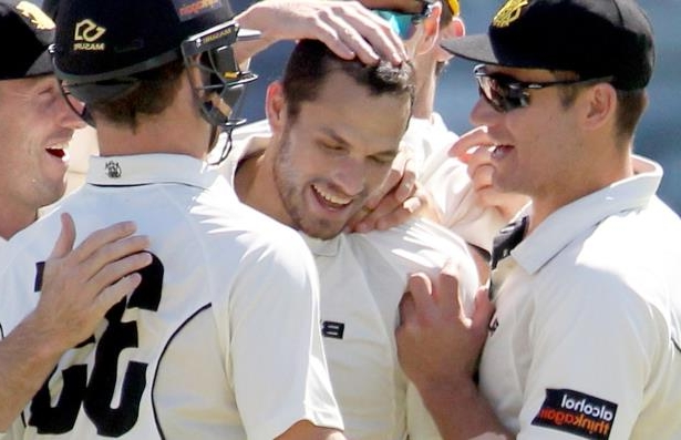Nathan Coulter-Nile of Western Australia celebrates with teammates after dismissing George Bailey of Tasmania during day 4 of the JLT Sheffield Shield match between Western Australia and Tasmania.