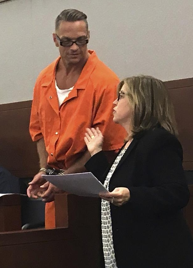 FILE - In this Aug. 17, 2017, file photo, Nevada death row inmate Scott Raymond Dozier confers with Lori Teicher, a federal public defender involved in his case, during an appearance in Clark County District Court in Las Vegas. Questions arose about the upcoming execution of death row inmate Dozier, who wants to die, with a disclosure in court that the state official who signed off on the untried three-drug protocol has resigned. Clark County District Court Judge Jennifer Togliatti responded with surprise Tuesday, Oct. 31, 2017, when she was told that Dr. John DiMuro quit Monday, Oct. 30, as chief state medical officer. (AP Photo/Ken Ritter, File)