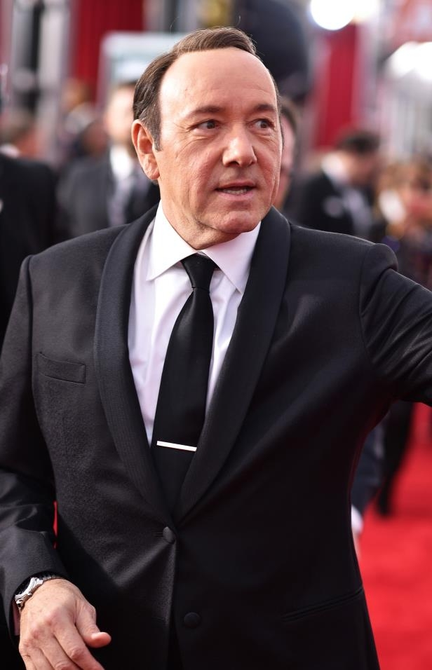 Kevin Spacey wearing a suit and tie