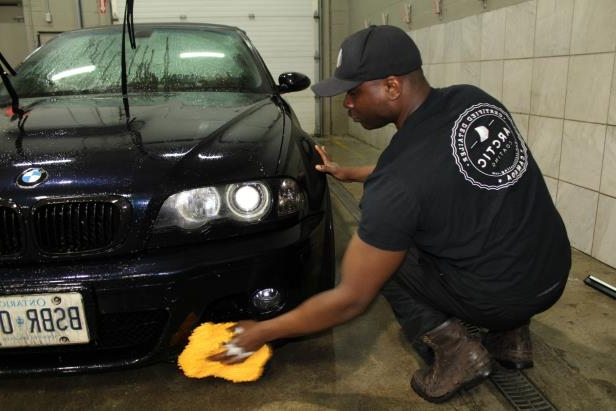 a man standing in front of a car: paint protection products