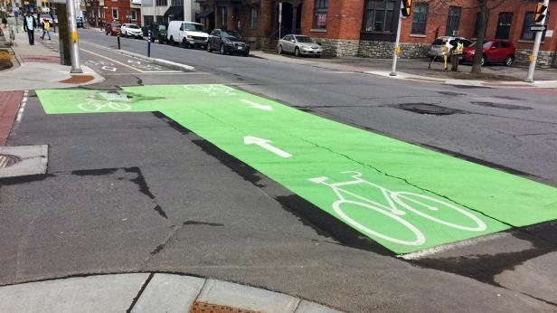 a close up of a busy city street: Bicycle Lane Marking and Box