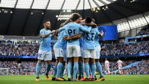 Manchester City - cropped: Manchester City players celebrate a goal.