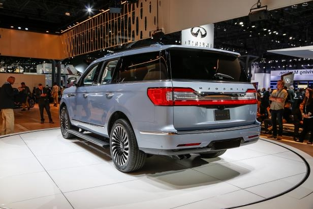 Slide 65 of 84: 2018-Lincoln-Navigator-rear-three-quarter.jpg