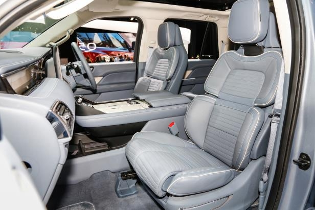 Slide 78 of 84: 2018-Lincoln-Navigator-front-interior-seats-1.jpg