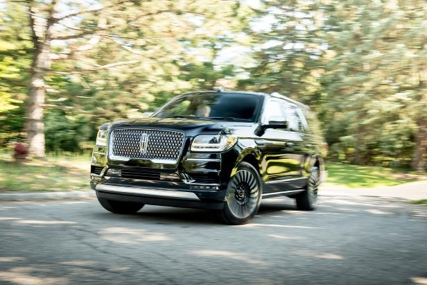 Slide 8 of 84: 2018-Lincoln-Navigator-Extended-Length-front-three-quarter-in-motion-01.jpg