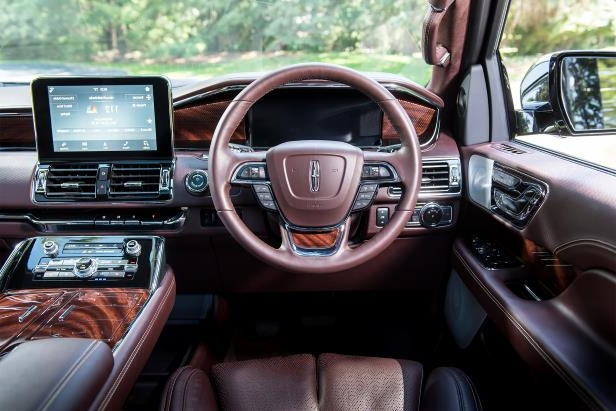 Slide 9 of 84: 2018-Lincoln-Navigator-Extended-Length-steering-wheel-and-center-stack.jpg