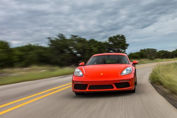 Slide 13 of 29: 2017-Porsche-718-Cayman-front-view-in-motion-04.jpg