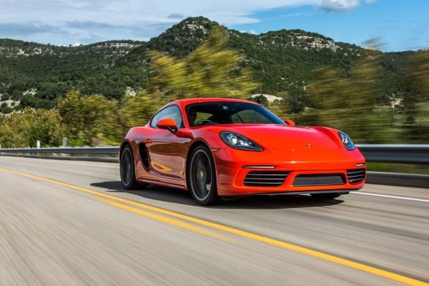 Slide 17 of 29: 2017-Porsche-718-Cayman-front-three-quarter-in-motion-01.jpg