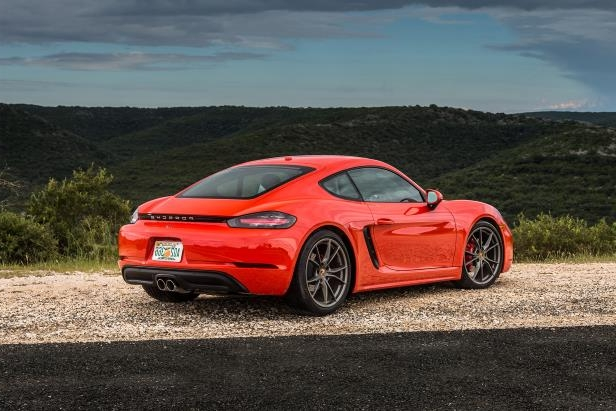 Slide 2 of 29: 2017-Porsche-718-Cayman-rear-three-quarter.jpg