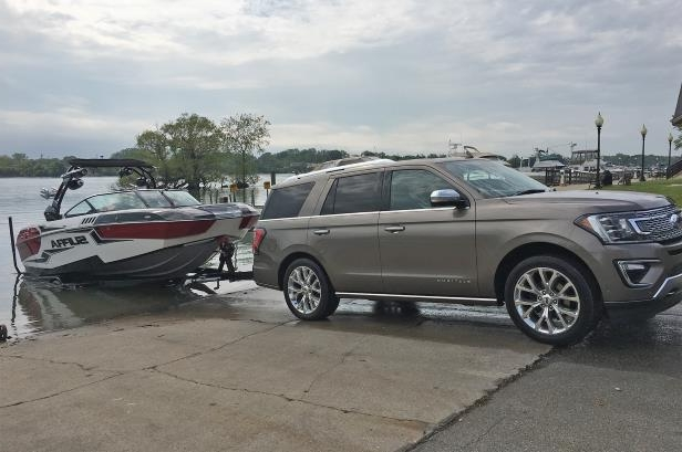 Slide 21 of 61: 2018-Ford-Expedition-with-tow-assist-side-view.jpg
