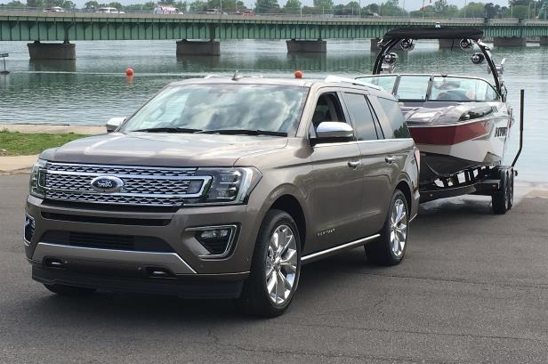 Slide 24 of 61: 2018-Ford-Expedition-with-tow-assist-front-three-quarter.jpg