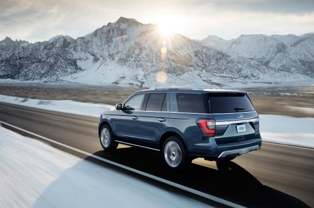 Slide 4 of 61: 2018-Ford-Expedition-rear-three-quarter-in-motion-1.jpg