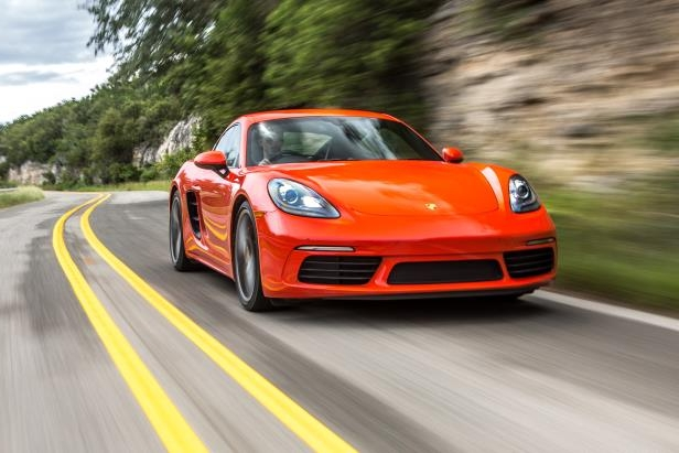 Slide 5 of 29: 2017-Porsche-718-Cayman-front-three-quarter-in-motion-04.jpg