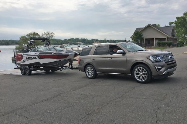 Slide 5 of 61: 2018-Ford-Expedition-with-tow-assist-front-side.jpg