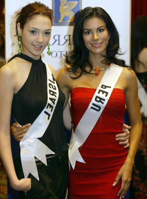 Slide 8 of 11: Miss Peru Liesel Holler and Miss Israel Gal Gadot pose for the photographers 17 May 2004, in Quito City, Ecuador, during the First session of interviews. The Miss Universe 2004 contest will take place 01 June 2004. AFP PHOTO/Martin BERNE