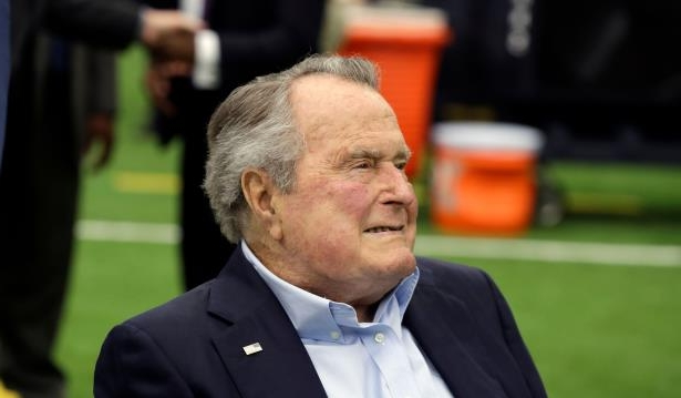 Former president George H.W. Bush arrives for an NFL football game between the Houston Texans and the Indianapolis Colts, Sunday, Nov. 5, 2017, in Houston.