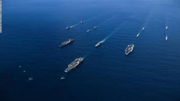 US Navy aircraft carriers USS Ronald Reagan (CVN 76), USS Theodore Roosevelt (CVN 71) and USS Nimitz (CVN 68) along with their strike groups transit the Western Pacific with ships from the Japanese Maritime Self-Defense Force over the weekend. Two US Air Force B-1 bombers can been seen in the lead.