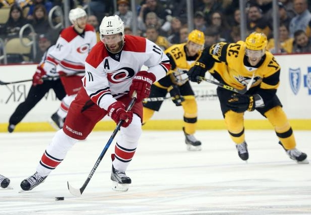 a hockey player on the field: NHL: Carolina Hurricanes at Pittsburgh Penguins